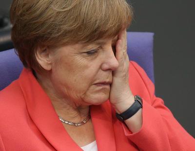 Merkel no disimula su reacción cuando Rajoy le dice que Podemos va segundo en los sondeos