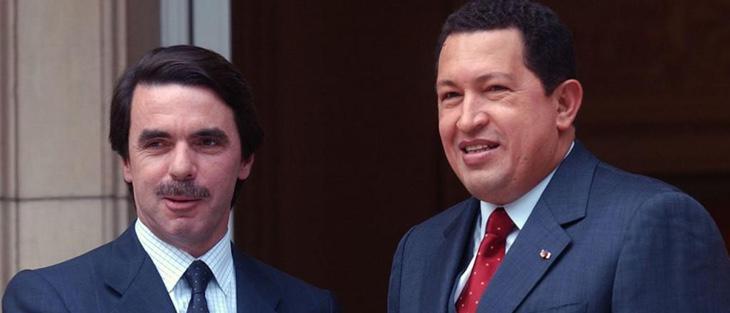 Podemos firmando contratos con el régimen chavista