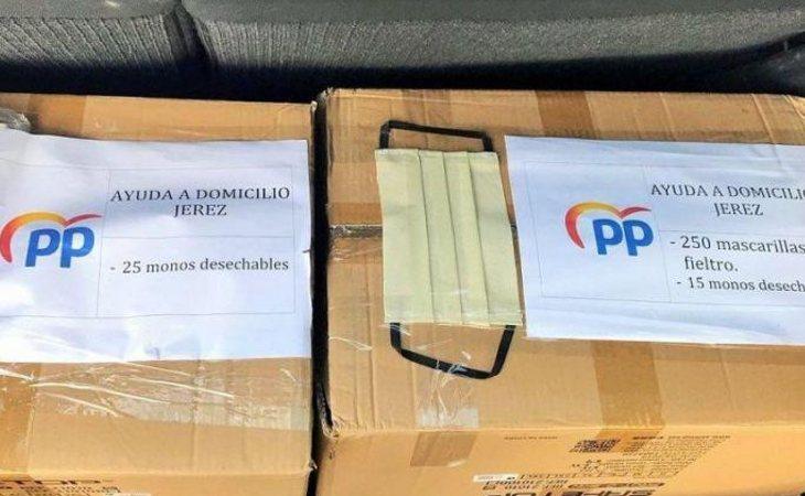 Mascarillas repartidas por el PP con el logo del partido
