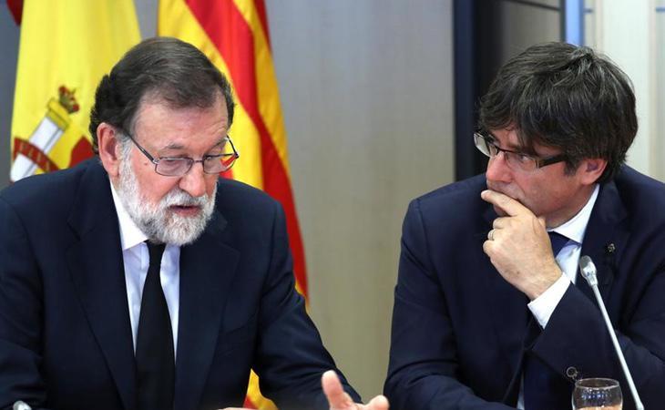 Mariano Rajoy junto a Carles Puigdemont