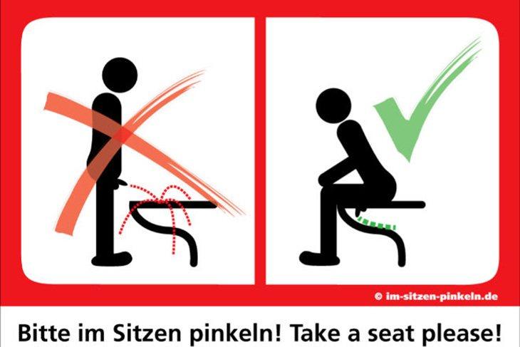Uno de los carteles alemanes que indican que hay que mear sentado