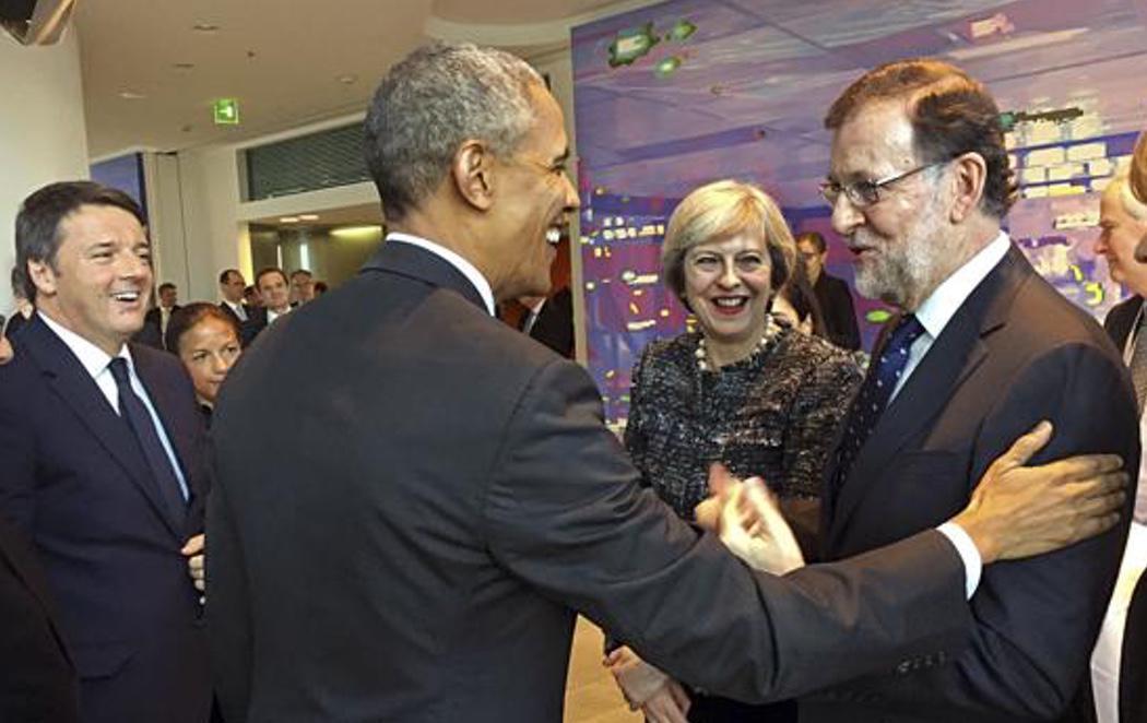 Obama y Rajoy se encuentran en la Cumbre de Berlín